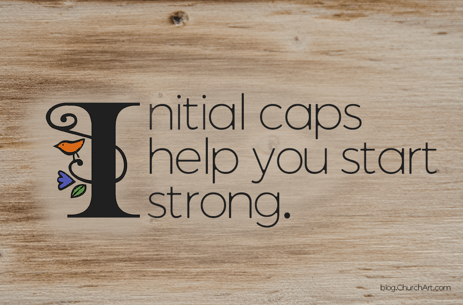 Initial caps typography on wood background