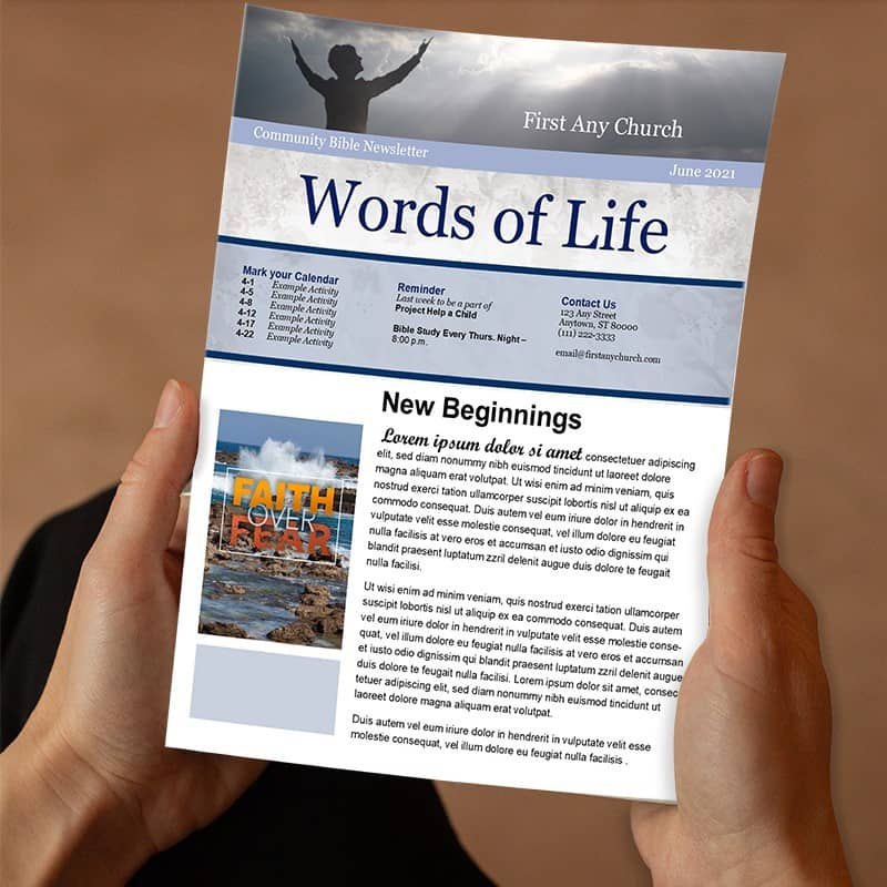 A photo of a person's hands holding a church newsletter in their hands
