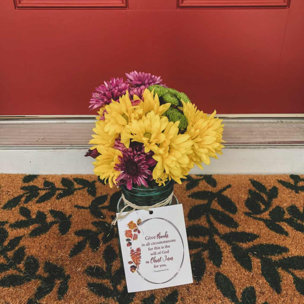 Flowers in mason jar on doorstep